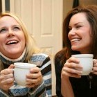 two friends having coffee together