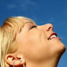 Woman looking up in gratitude