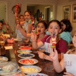 children making fruit kabobs in a Yum101! cooking class