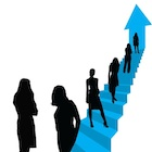 silhouette of women going up the leadership ladder